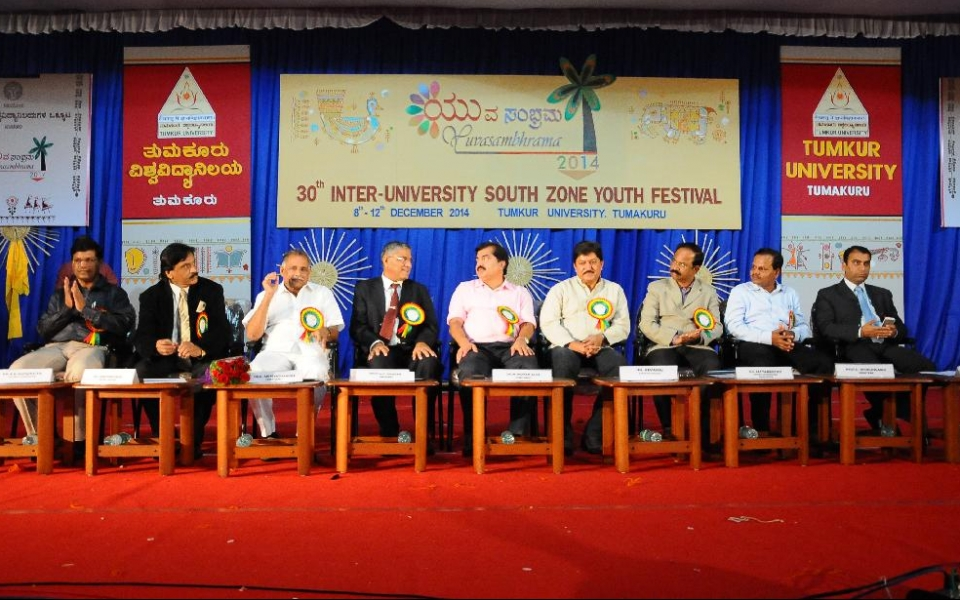 Valedictory day of Yuvasambharam 2014 - 30th  Inter University South Zone Youth Festival. (From Left)  Dr. A.M.Manjunath, Cultural Coordinator; Sri David Sampson, Joint Secretary, AIU; Sri Abhaychandra Jain, Hon'ble Minster of State for Youth Services, Sports and Fisheries; Prof. A.H. Rajasab, Vice Chancellor; Dr. M. Mohan Alwa, Artists and Educationist; Sri Devaraj, Film Star; Sri Satyamurthy, DC; Prof. D. Shivalingaiah, Registrar; and Dr. Sourabh Lakhanpal are on the Dais.