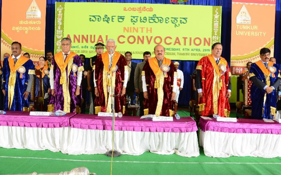 Ninth Convocation held on 6 April 2016. (From Left) Prof. D V Paramashivamurthy, Registrar (Evaluation);  Prof. A H Rajasab, Vice Chancellor, His Excellency, the Chancellor and Governor of Karnataka, Shri Vajubhai Vala; Shri T B Jayachandra, Honourable Minister for Higher Education and Pro Chancellor; Honourable Justice Shri Santhosh Hegde; Prof. M Venkateshwarlu, Registrar are seen.